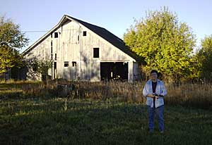 Diane Wright and the barn that features in one of her drawings.